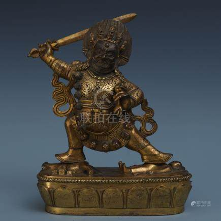 TIBETAN GILT BRONZE STANDING BUDDHIST GUARDIAN