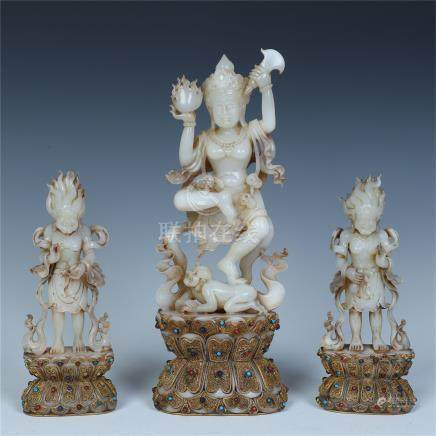 THREE CHINESE JADE STANDING BUDDHA WITH TWO GUARDIANS ON GILT SILVER ENAMEL BASE