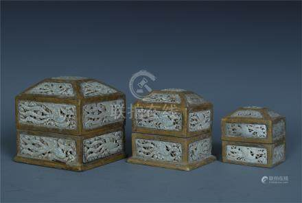 THREE JADE PLAQUE GILT BRONZE NESTING BOXES
