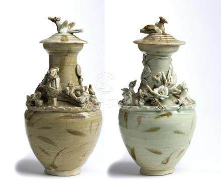 A PAIR OF QINGBAI-GLAZED URNS AND COVER WITH APPLIED DECORAT