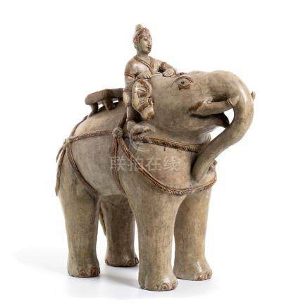 A CÉLADON-GLAZED CERAMIC ELEPHANT AND FIGURE