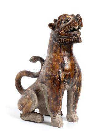 A GLAZED CERAMIC LION