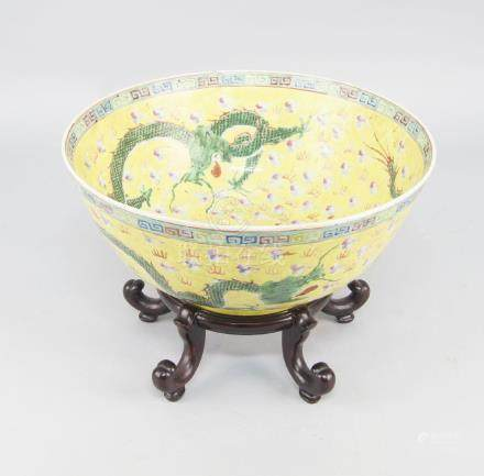 A Chinese porcelain bowl, 20th century, decorated with green long dragons among stylised multi-