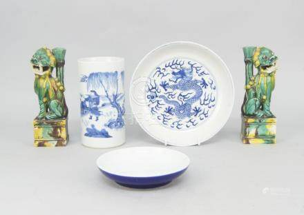 A pair of Chinese porcelain incense burners, early 20th century, in the form of seated lions, with