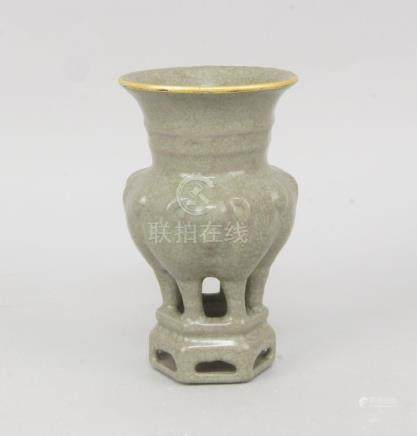A Chinese celadon crackleware censer, late19th/early 20th century, the globular body moulded with