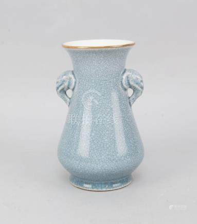 A Chinese pale blue crackleware stoneware vase, late 19th/early 20th century, with elephant form