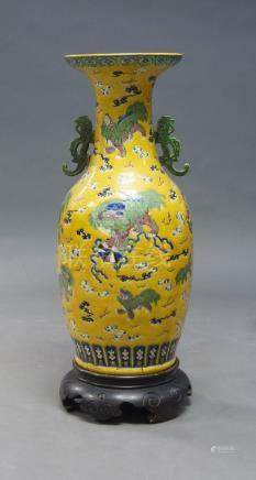 A large Chinese porcelain vase, 20th century, incised with temple lions and cubs amidst trailing