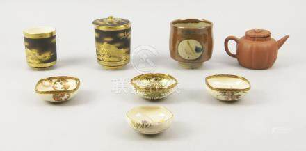 A collection of four small Japanese Satsuma dishes, early 20th century, decorated with bamboo,