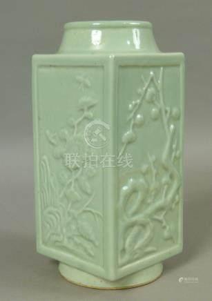 A CHINESE CELADON PORCELAIN VASE of square panelled form,