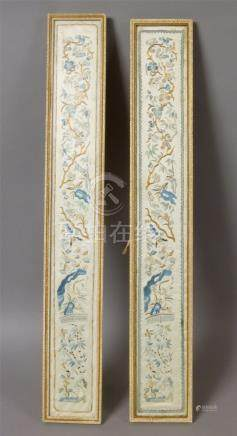 A PAIR OF CHINESE SILK EMBROIDERED PANELS worked in pale blue, ivory and gilt threads with bamboo,