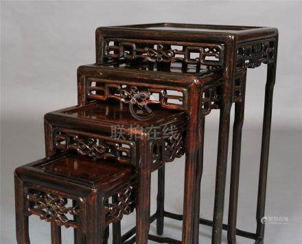 A CHINESE NEST OF FOUR HARDWOOD TABLES, of square outline,