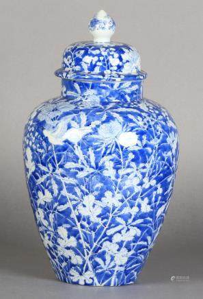 A JAPANESE BLUE AND WHITE VASE AND DOMED COVER with bud finial, ovoid,