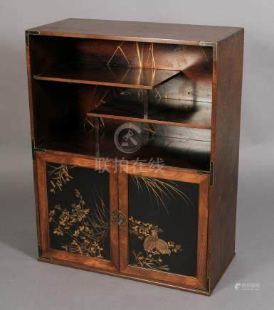A JAPANESE BLACK LACQUERED AND GILT CABINET, Meiji period,