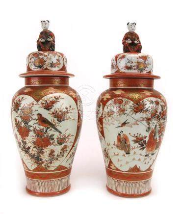 A pair of Kutani covered vases of urn shaped form, the covers with figural finial's,