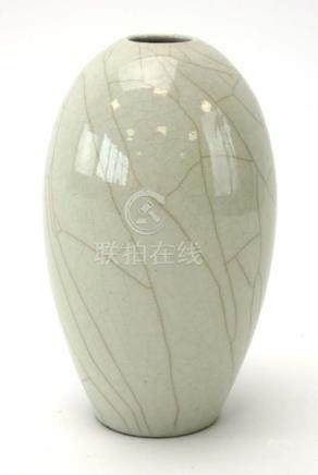 A modern Chinese vase of slender ovoid form decorated in a pale grey crackle glaze,