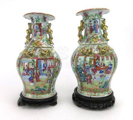 A pair of late 19th/early 20th century Cantonese vases of baluster form decorated in coloured