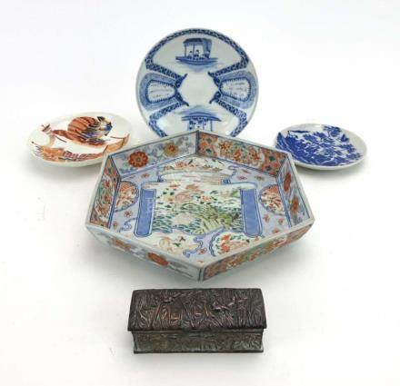 A Japanese Imari dish of hexagonal form decorated with a pair of fighting foo dogs within a scroll,