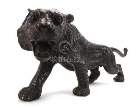 A brown patinated bronze figure modelled as an outstretched tiger, signed A. Toit, l.