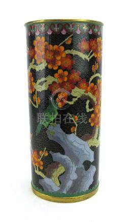 A cloisonne enamelled vase of cylindrical form decorated with a song bird and blossoming branches