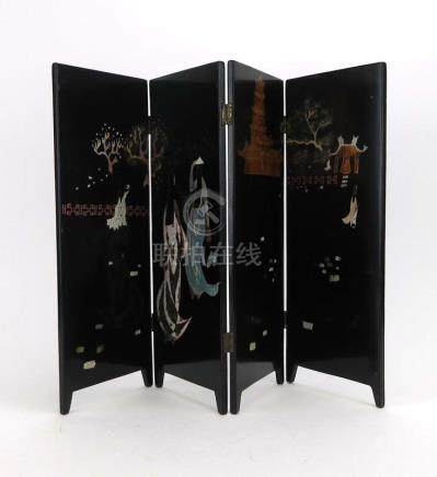 A modern lacquered four section table screen decorated with figures travelling to a pagoda, h.