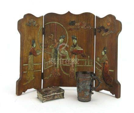A wooden three panel table screen of scalloped form relief decorated in coloured hardstone with