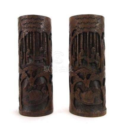 A pair of carved bamboo brush pots of cylindrical form,