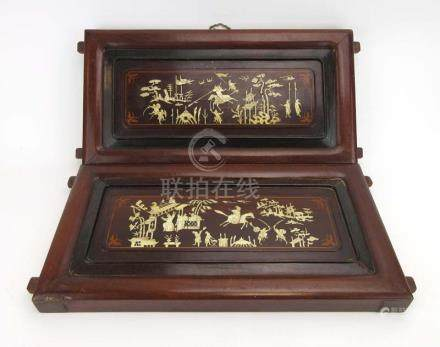A pair of 19th century rosewood and bone inlaid panels, each decorated with a battle scene, w. 52.