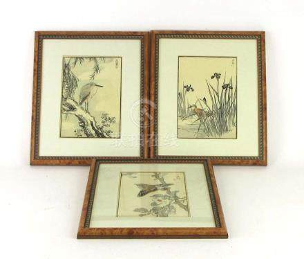 A set of three Japanese woodblock prints each depicting a bird within a foliate setting, signed,