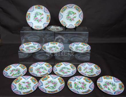 Pair of early 19th century bread plates and eleven side plates to match, each decorated in the