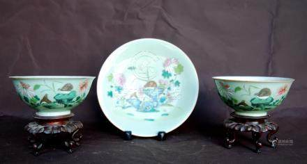 Pair of early 20th century Chinese celadon bowls with bird and flower decoration and calligraphy,
