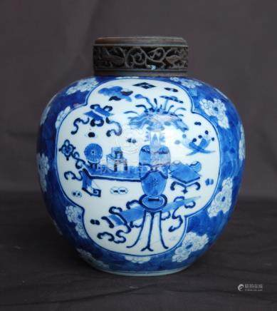 19th century Chinese small blue and white ginger jar with carved wooden cover decorated with