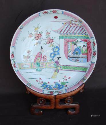 Chinese late 19th or early 20th century famille rose dish and carved wooden stand, 36cm diameter,