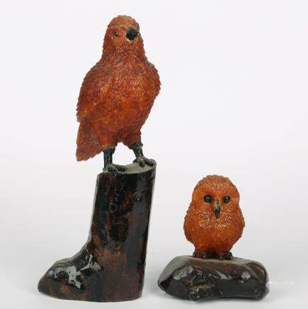 CHINESE PAIR OF AMBER CARVED BIRDS