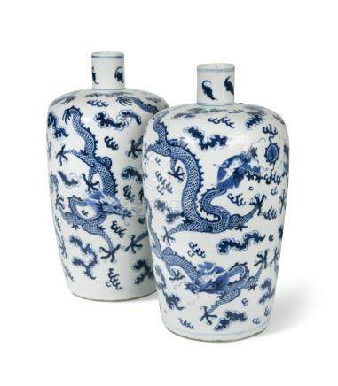 Two similar blue and white dragon vases, Qing Dynasty, 19th century, with cylindrical necks