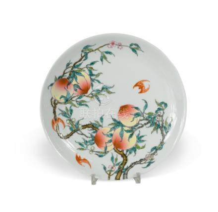 A Chinese porcelain shallow dish, Republic Period (1912-1949), of circular shape, enamelled with