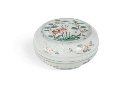 A Chinese circular box and cover, Ming dynasty, enamelled with flowers and foliage, 10cm diameter