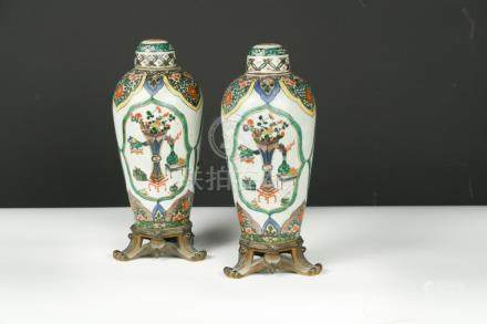 A pair of 19th Century gilt metal mounted famille verte type vases and covers, possibly Samson,