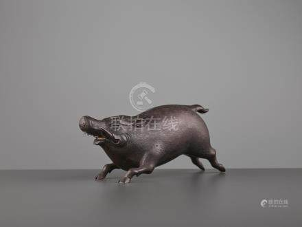 A FINE BRONZE OF A RUNNING BOAR