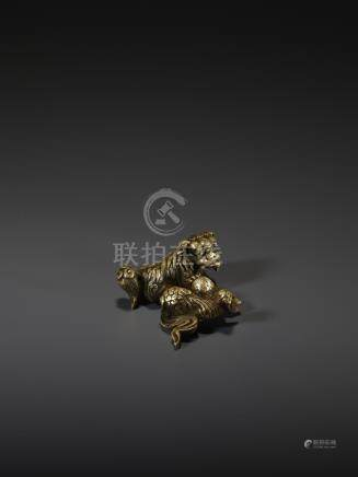 A SHISHI BRONZE SCROLL WEIGHT