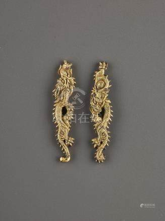 A PAIR OF GILT SHAKUDO DRAGON MENUKI