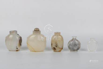 Set of four white glass snuff bottles