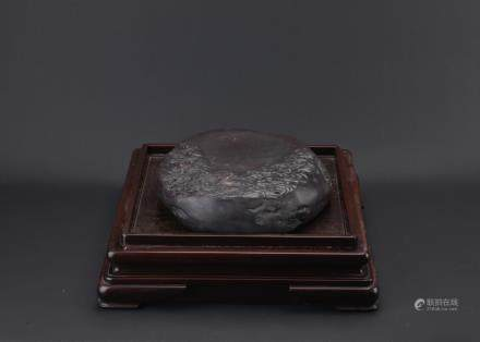 A VERY LARGE INKSTONE WITH HARDWOOD STAND
