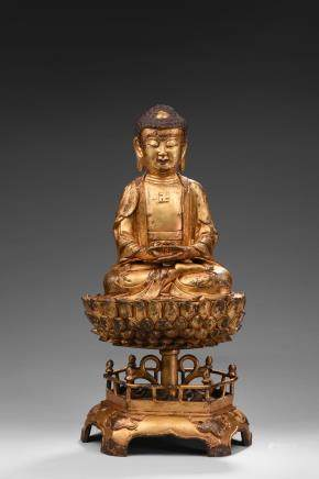A GILT BRONZE FIGURE OF AMITABHA UPON STAND