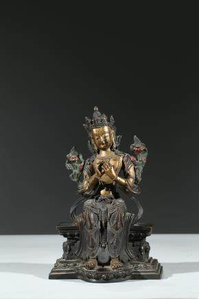 A PARCEL-GILT BRONZE FIGURE OF MAITREYA