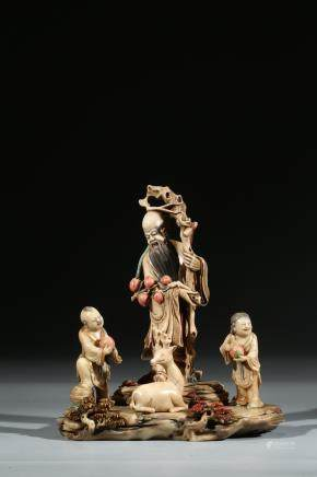 A SHOUSHAN STONE CARVED FIGURAL GROUP