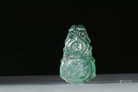 A JADEITE CARVED DOUBLE GOURD PENDANT