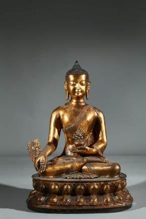 A GILT BRONZE FIGURE OF BHAISAJYAGURU