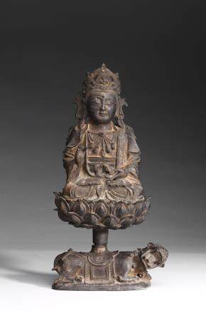A BRONZE FIGURE OF GUANYIN ON QILIN