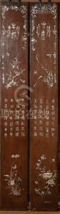 Indochine, vers 1900  Deux grands panneaux verticaux en bois de rose et incrust