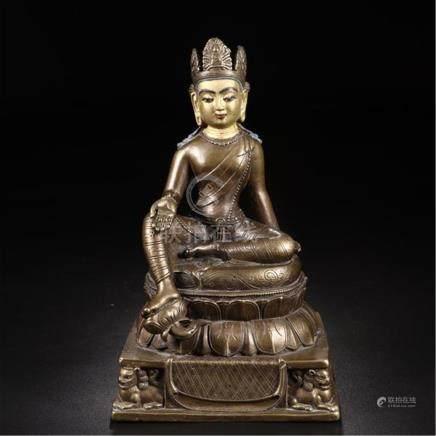 CHINESE PARTLY GILT BRONZE SEATED BUDDHA